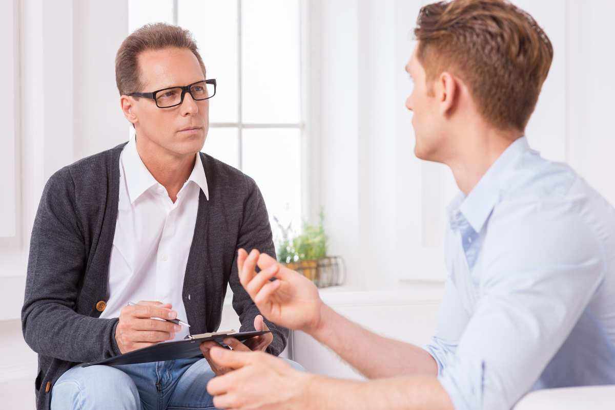 man listening to client, offering client-driven solutions